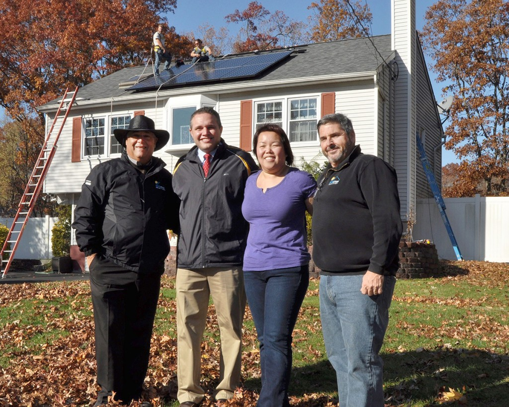 Shown (from left) are: SUNation co-founder and chief of sales Mike Bailis, councilman Kevin LaValle, Linda Tong, and SUNation co-founder and CEO Scott Maskin.