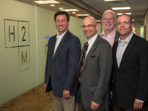 Shown (from left) are: Richard Humann, P.E., president and CEO, H2M; David Pacheco, AIA, NCARB, co-owner, PRA; Dennis Ross, AIA, NCARB, co-owner, PRA; and Joseph Mottola, R.A., senior vice president, director of architecture, H2M.